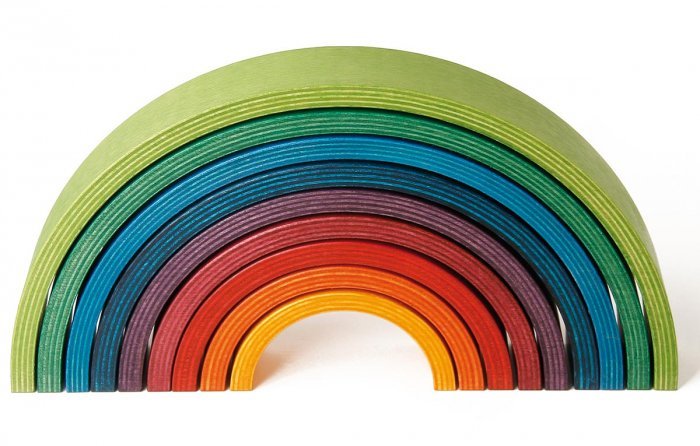 9 piece Naef wooden stacking rainbow on a white background.