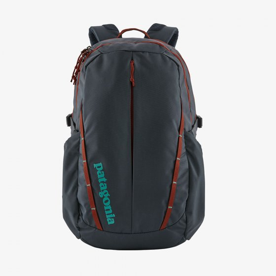 Picture of the smolder blue and red roots Refugio 28L backpack. Picture background is white.