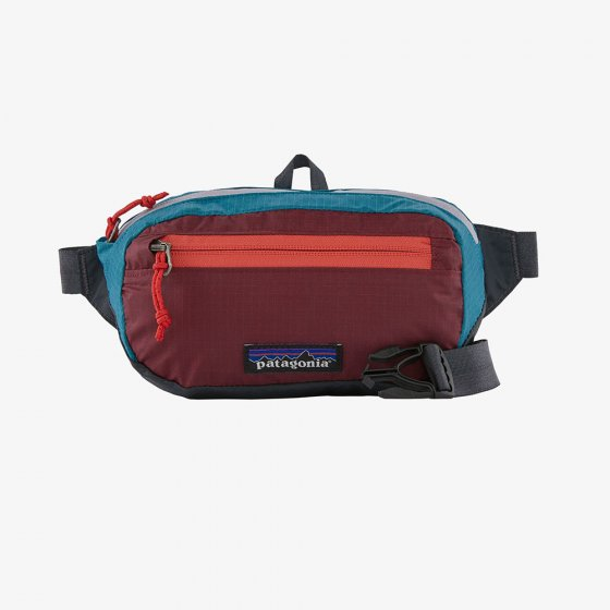 Patagonia ultralight black hole  mini hip pack in patchwork and roamer red.