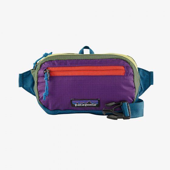 Patagonia ultralight black hole mini hip pack in patchwork and Steller blue.