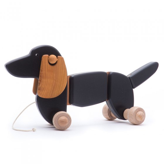Bajo sustainable wooden pull dog toy on a white background