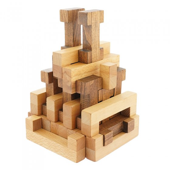 Drei Blätter New Blocks wooden shapes stacked into a geometric tower on a white background