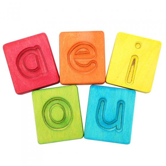 Hellion Toys eco-friendly rainbow vowel cubes laid out in 2 rows on a white background