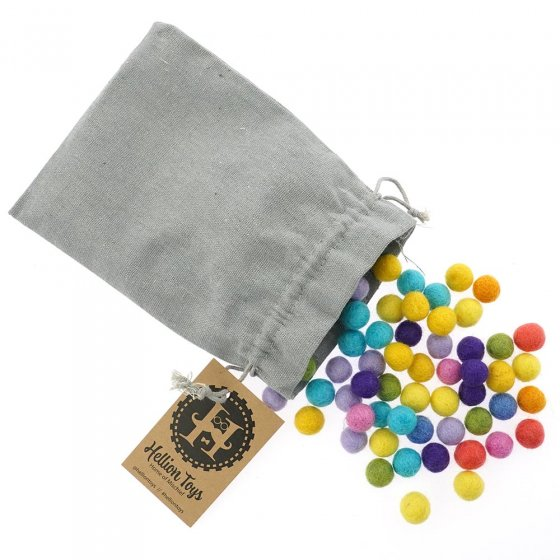 Hellion Toys 100 eco-friendly natural merino wool balls pouring out of a grey drawstring bag on a white background