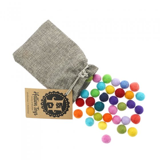 Hellion Toys eco-friendly natural merino woollen balls pouring out of a grey bag on a white background