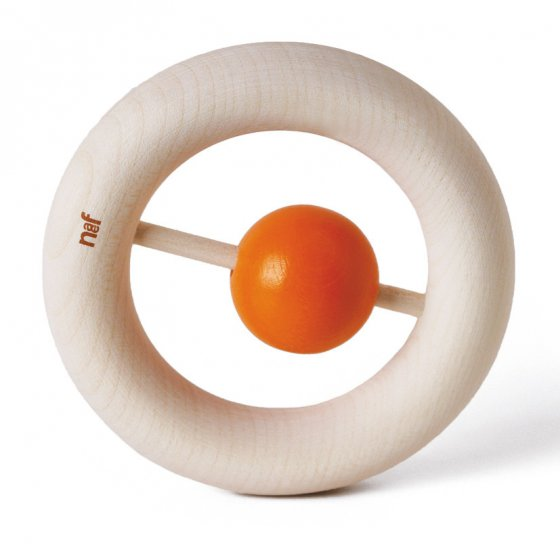 Naef's wooden Kauring baby teether stood up on end highlighting donut design with small orange rattle in the centre. Toy is placed on a white background.