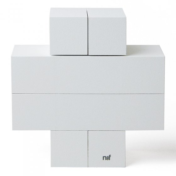 4 identical pieces of Naef's Quadrigo wooden toy slotted together to make a cross shape on a white background.