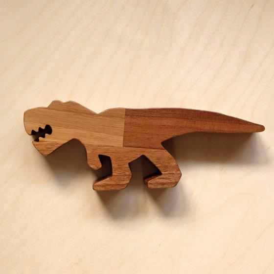 O-WOW eco-friendly Walnut T-Rex toy on a bright wooden background