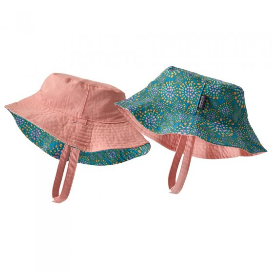 Picture of two baby bucket hats side by side. One pink and the other a tropical bloom pattern to show what the reversible sides of the sun hat look like. Picture background is white.