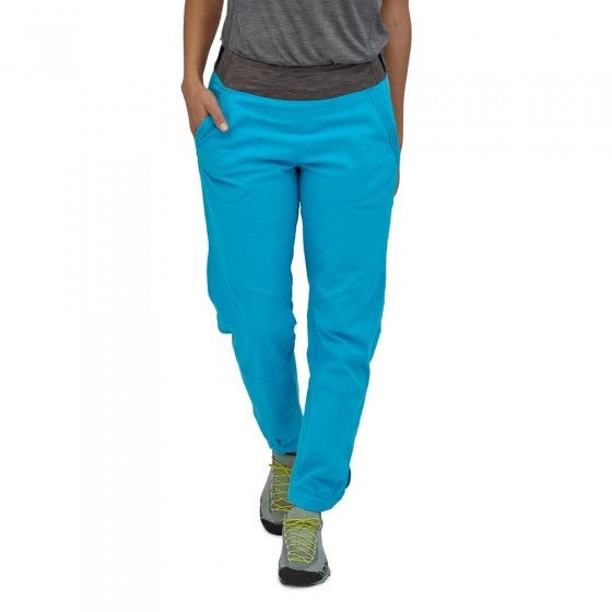 Picture of model wearing Patagonia Caliza Rock Pants in blue. Picture background is white.