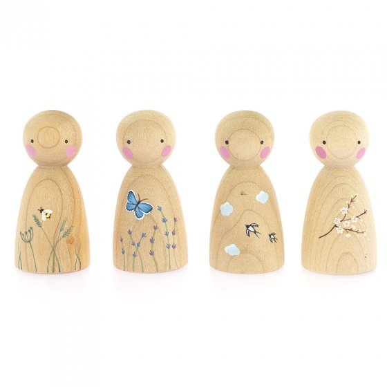 Peepul Signs of Spring Doll toy set in a line on a white background