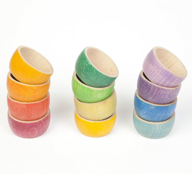 Grapat 12 Rainbow Wooden Sorting Bowls, stacked in the colours of the rainbow. Perfect toy bowls for sorting, counting and matching. White background.