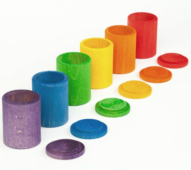 Grapat 6 Wooden Toy Rainbow Cups with lids off, lined up in rainbow colour order. For colour matching, sorting, stacking and holding treasures. White background.