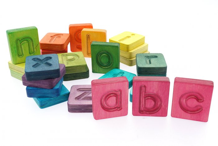 Hellion Toys sustainable rainbow alphabet cubes laid out on a white background