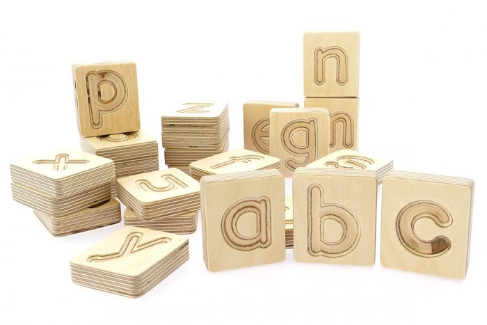 Hellion Toys sustainable wooden alphabet letter toy set laid out on a white background