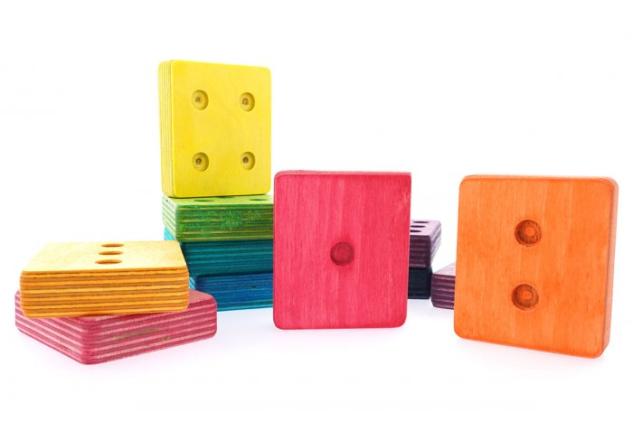 Hellion Toys handmade wooden rainbow dot cubes laid out on a white background