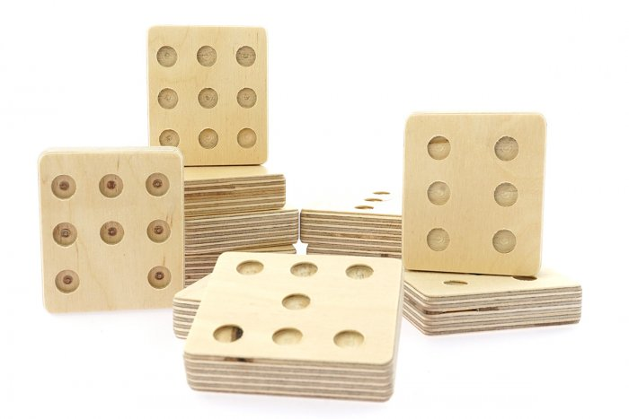 Hellion Toys eco-friendly wooden dot cube toys laid out on a white background