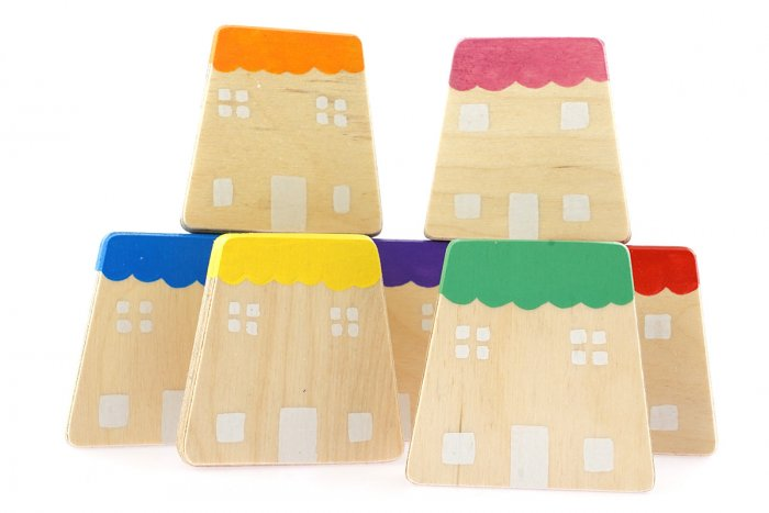 Hellion Toys handcrafted wooden rainbow house toys stacked on a white background