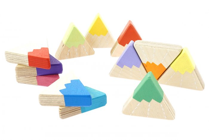Hellion Toys sustainable handmade rainbow mountain toys scattered on a white background