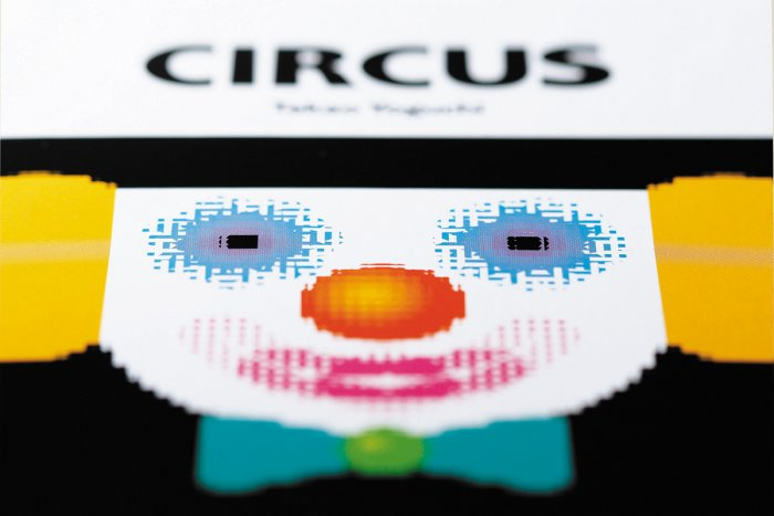 Naef's Circus Moire Illusion book cover featuring distorted colourful clowns face and title, Circus.