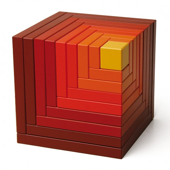 Naef's Cella stacking cube toy in red on a white background. Toy is in its original cube form.